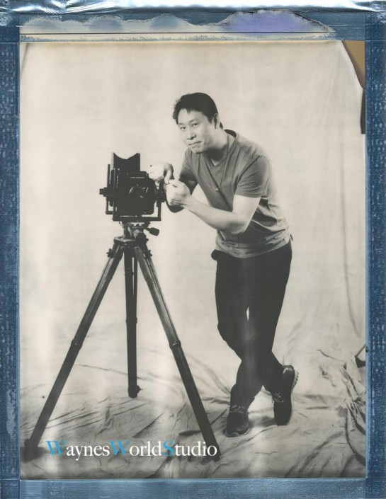 Photographer Wayne Lam with View Camera on tripod in studio setting, artsy self-portrait