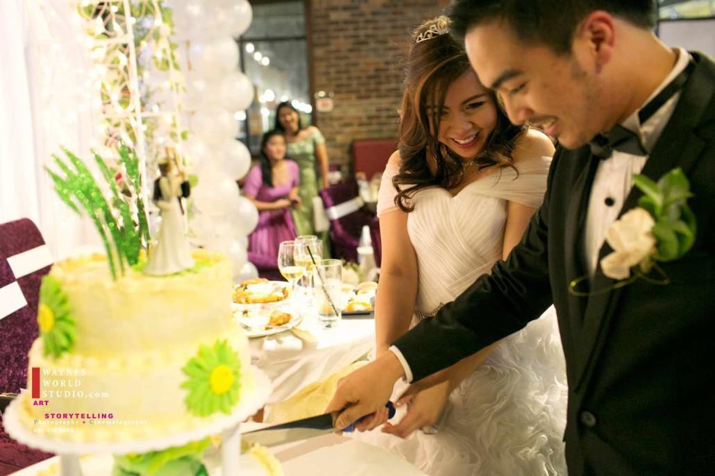 Filipino wedding young couple cutting cake